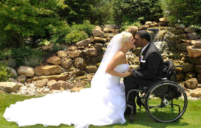 groom in wheelchair at sunset | - 52.6KB